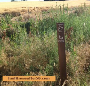 One of the Kingfisher Trail mileage markers around Lake Lowell in Nampa, Idaho.